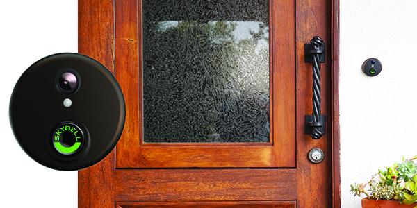 black Skybell doorbell with wood front door