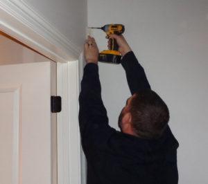 Technician Adam installs a motion detector
