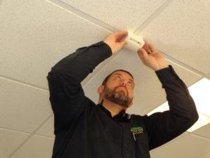 Technician Adam finishes installing a glass break sensor