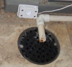 Side-mounted water sensor near floor drain